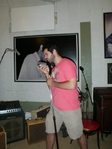 Posing in Sun Studios on the microphone that Elvis supposedly used.
